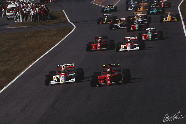 Senna and Prost dive into the first turn in Japan